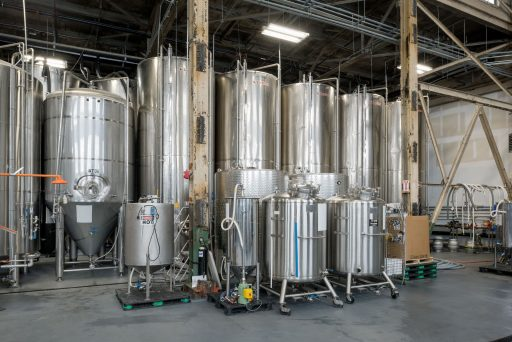 Stainless steel storage tanks in Downeast Cider House in Massachusetts, USA.