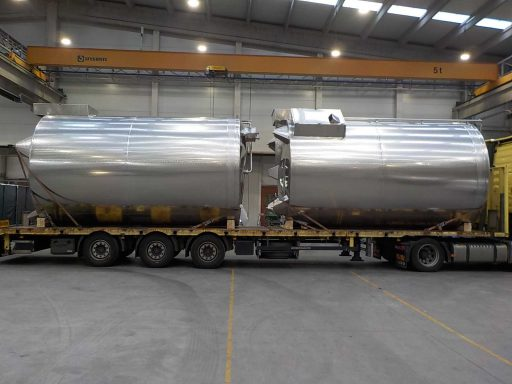 Giant stainless steel Insulated Tanks loaded on a truck.