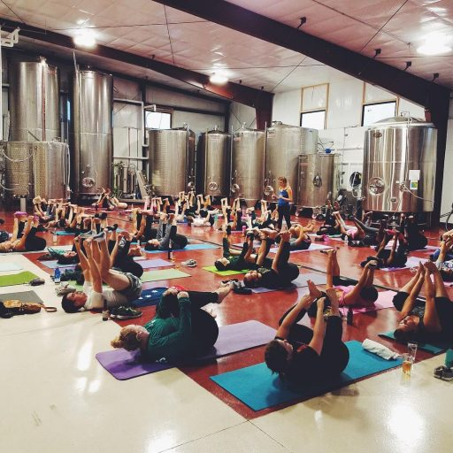 A yoga class in the Liquid Art Winery in Kansas, USA.