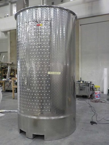 Back view of a 4900 L stainless steel Letina PV forklift transport tank with a lifting skirt and a cooling jacket.