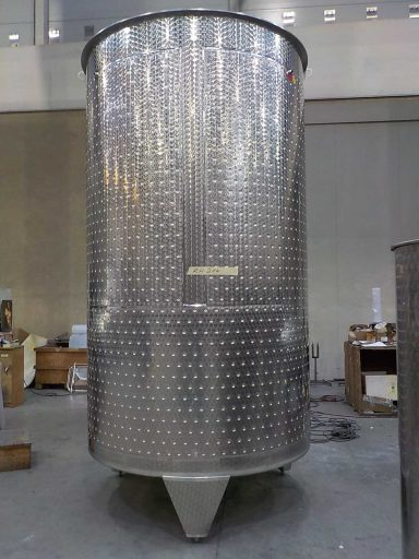 Back view of a professional, marbled 7300 L stainless steel Letina PZP variable capacity tank for wine with a cooling jacket.