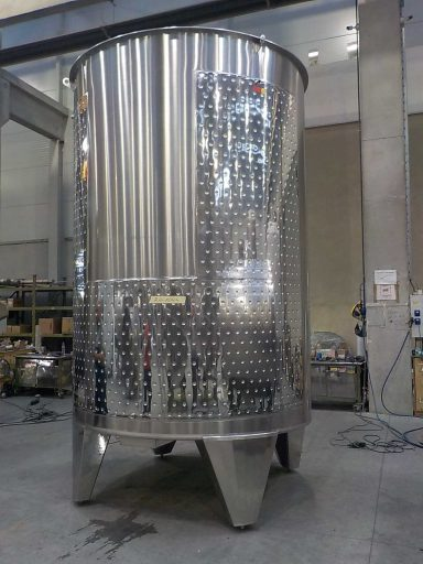 Back view of a professional, polished 9950 L stainless steel Letina PZPK sloped variable capacity tank for red wine with a cooling jacket.