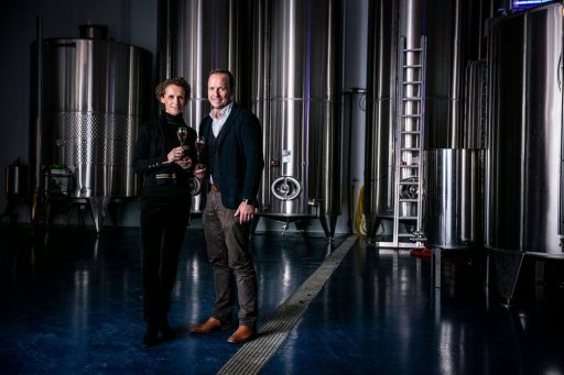 The owners of the Simpsons Wine Estate posing in front of Letina tanks.