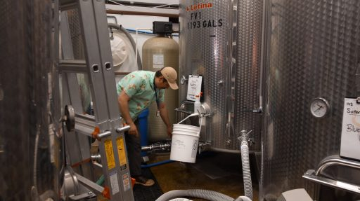Man working with a Letina tank at Superstition Meadery in Arizona, USA.