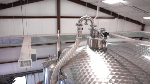 Top of a Letina stainless steel tank at Superstition Meadery in Arizona, USA.