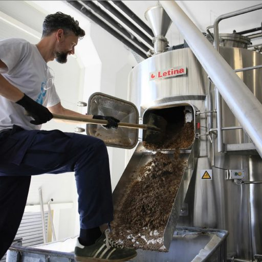 Man working with a mini brewery in the Varionica brewery in Croatia.