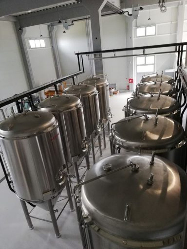 Top-down view of conical fermenters in the Varionica brewery in Croatia.