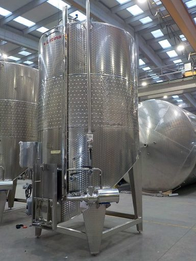 Side view of a 12000 L stainless steel Letina VIKS pump-over fermenter with a spoon bottom.