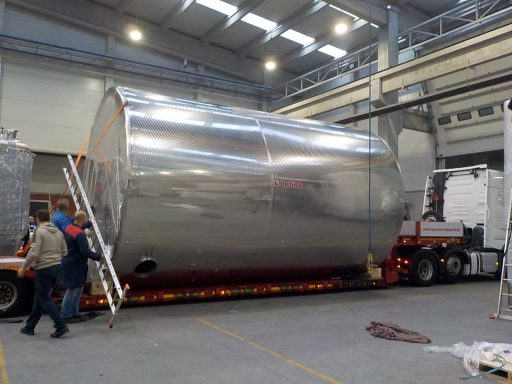 Huge [Z] Closed storage tank by Letina (100 000 L) loaded on a truck.