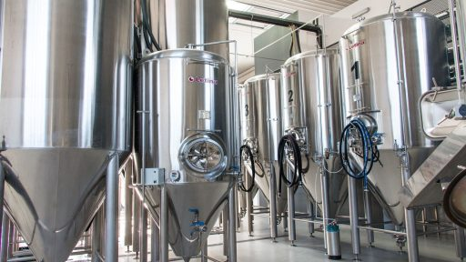 Assortment of conical fermenters in a craft brewery.