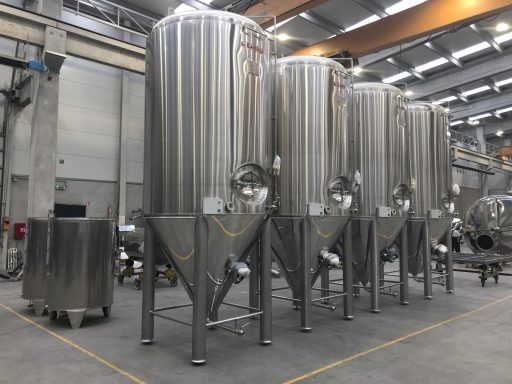 Conical fermenters lined up.