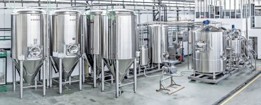 Conical fermenters in a brewery set up.