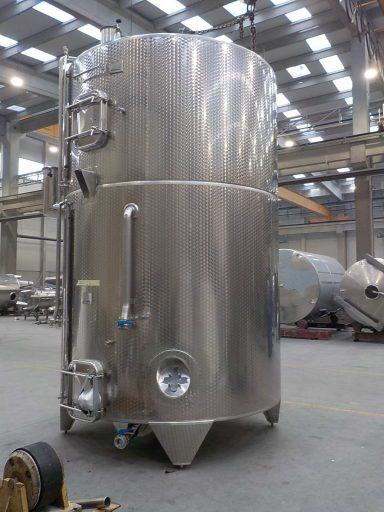Side view of a large stainless steel Letina ZK multi-chamber tank with a 10700 L and 7600 L chamber.